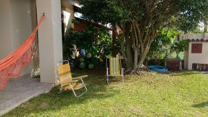 Jardín al aire libre en Casa temporada na praia de Atlântida Sul
