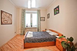 A bed or beds in a room at StudioMinsk 5 Apartments