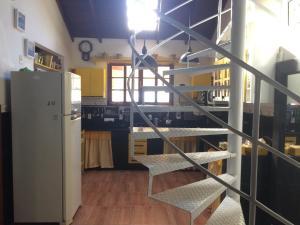 Una cocina o zona de cocina en CASA FLORIANÓPOLIS