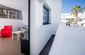 A balcony or terrace at Migjorn Ibiza Suites & Spa