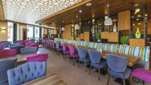 Ein Restaurant oder anderes Speiselokal in der Unterkunft Stay! Hotel Boardinghouse