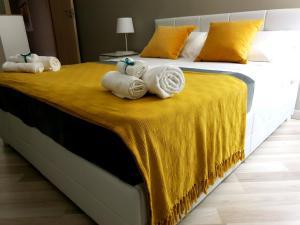 Letto o letti in una camera di StesicorHomes Suite&Spa