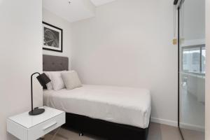 Ein Bett oder Betten in einem Zimmer der Unterkunft Arise Brisbane Skytower