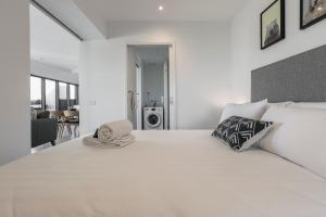 A bed or beds in a room at Flinders Luxury Penthouse