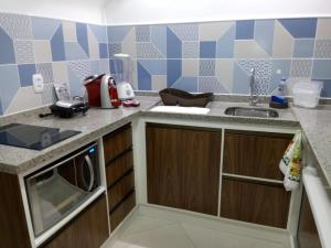 A kitchen or kitchenette at 6 Landscape Beira Mar Fortaleza