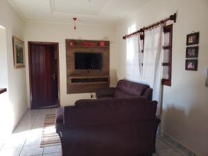 A seating area at Casa para temporada em bonito