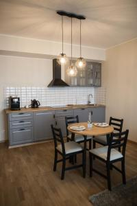 A kitchen or kitchenette at UP 34 FLOOR APARTMENTS