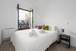 A bed or beds in a room at Modern With Ideal Location Next To Atocha Station