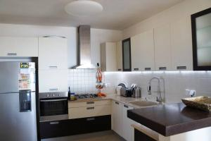 A kitchen or kitchenette at Luxury Apartment on the beach