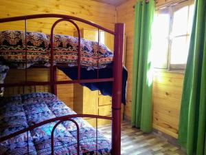 Una cama o camas cuchetas en una habitación  de El Andino