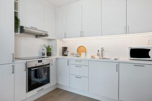 A kitchen or kitchenette at BJØRVIKA APARTMENTS, Opera Area, Oslo city center