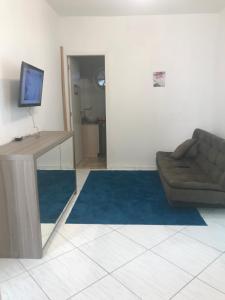 Una televisión o centro de entretenimiento en Apartamento