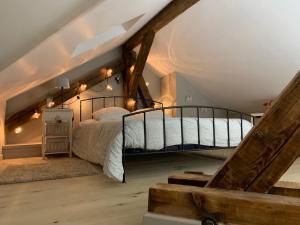 Un ou plusieurs lits dans un hébergement de l'établissement Copropriété de la Place