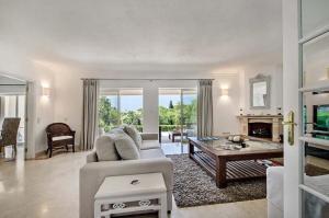 A seating area at Quinta do Lago Villa Sleeps 10 Pool Air Con T479956
