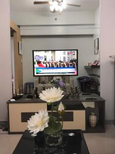 A television and/or entertainment center at Grass Residence, Fern Tower 4