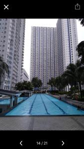 The swimming pool at or near Grass Residence, Fern Tower 4
