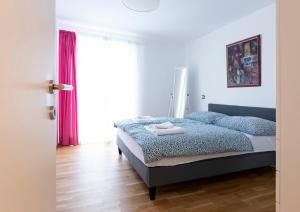 Ein Bett oder Betten in einem Zimmer der Unterkunft Barrierfree 3-room-flat TOP2