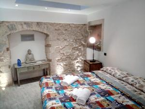 Letto o letti in una camera di Via Pezza 100