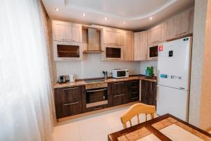 Кухня или мини-кухня в Apartment on the Sadovaya