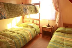 A bunk bed or bunk beds in a room at Cabañas Don Gaspar