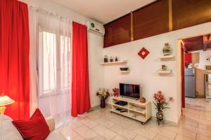 A television and/or entertainment center at Amadeus Studio