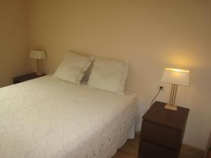 A bed or beds in a room at Apartamentos Grifo Vacances Julia