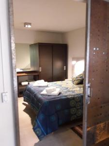 Una cama o camas en una habitación de Umain Plaza