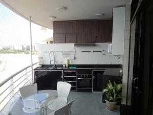 A kitchen or kitchenette at Flat Tropical Particular