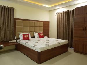 A bed or beds in a room at Areia De Goa Arpora