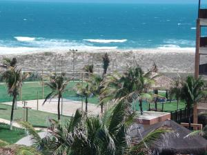 A view of the pool at Conforto e Lazer no Porto das Dunas or nearby