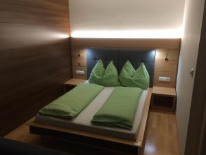 Ein Bett oder Betten in einem Zimmer der Unterkunft Haus Arosa