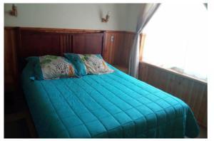 Cama o camas de una habitación en Acogedor departamento Pucón camino al volcán