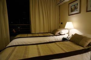 Cama o camas de una habitación en H Apart 802 Santa Beatriz 81 Providencia