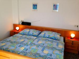 A bed or beds in a room at Appartements D'Angelo
