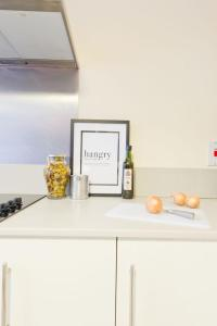 A kitchen or kitchenette at Broc House Suites