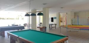 A pool table at Flat Rio Quente Serra Park (Propriedade Particular)