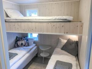 A bunk bed or bunk beds in a room at Mountain Chalet Ski in ski out