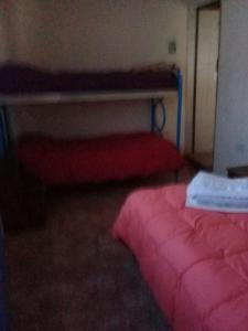 Una cama o camas en una habitación de El Andino
