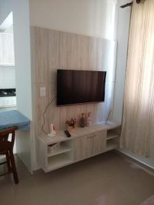 Una televisión o centro de entretenimiento en Residencial Santa Maria