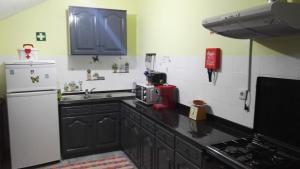 A cozinha ou kitchenette de T3 na Casa Do Moinho