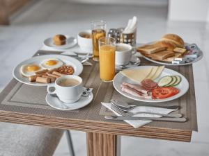 Možnosti snídaně pro hosty v ubytování Akropolis Apart Hotel