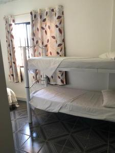 Litera o literas de una habitación en Residencial Costa do Sol