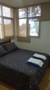 Una cama o camas en una habitación de Departamento JT Mendoza