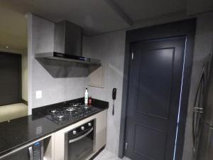 A cozinha ou cozinha compacta de Apartamento Conceito Barra Sul