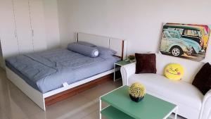 Кровать или кровати в номере NIRUN CONDO WELCOME YOU