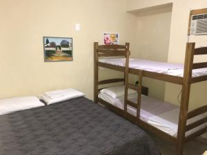 A bunk bed or bunk beds in a room at Kitnet no Derby, Recife - 206