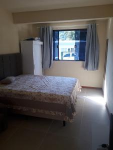 Cama o camas de una habitación en Beira Mar Jurere kit