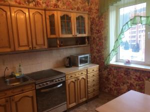 Кухня или мини-кухня в Апартаменты в курортной зоне