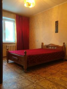 Кровать или кровати в номере Апартаменты в курортной зоне