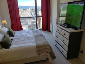 Una cama o camas en una habitación de Apart 440